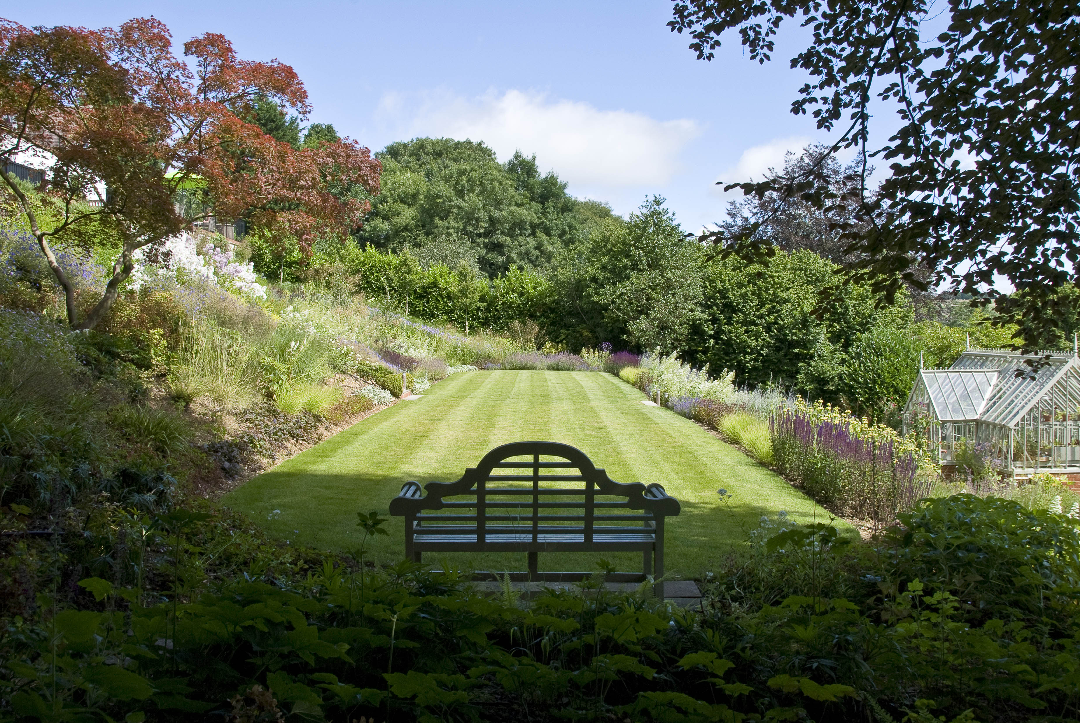 Acres Wild Steeply Sloping Bench on Lawn Area